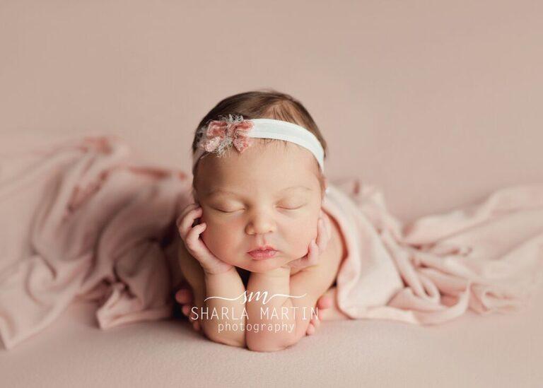 head in hands pose newborn photo