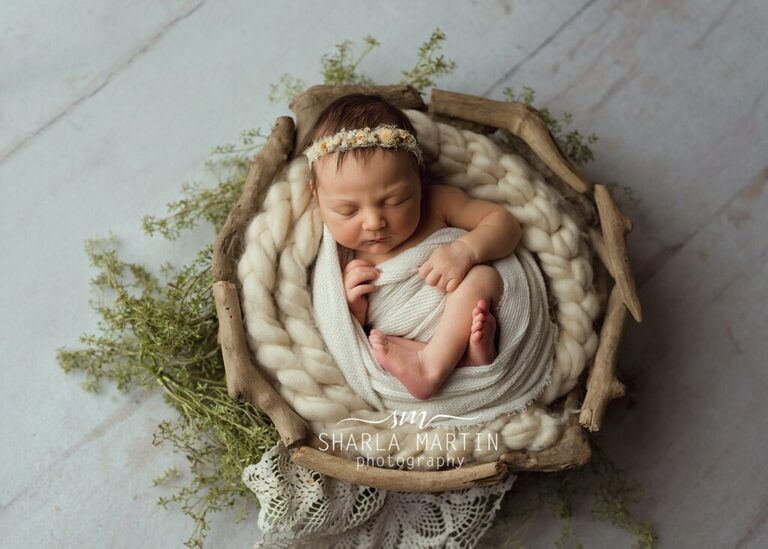 newborn pose in basket