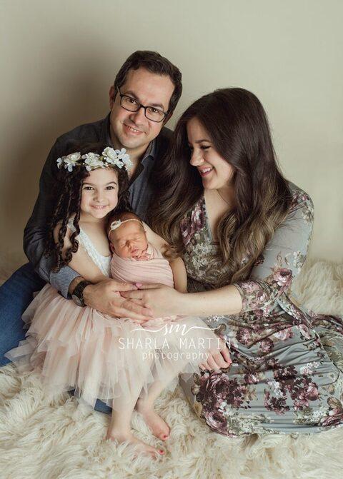 family newborn posing austin mom looking at baby